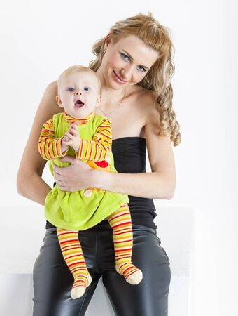 cradling: portrait of mother with her baby girl