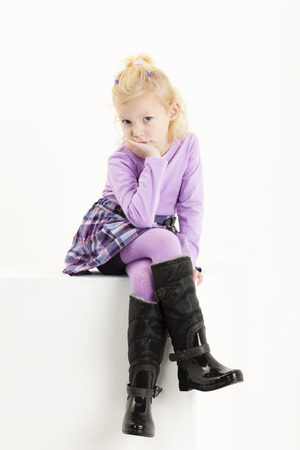 tights: sitting little girl wearing a skirt