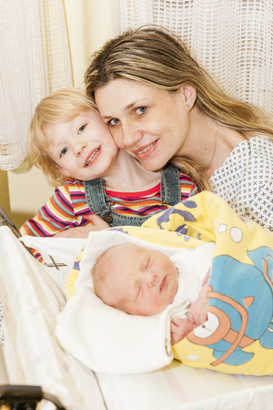 maternal: portrait of mother with her daughters in maternal hospital