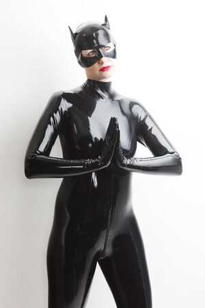 incognito: portrait of standing woman wearing latex clothes
