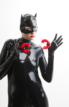 woman in handcuffs: portrait of woman wearing latex clothes with handcuffs