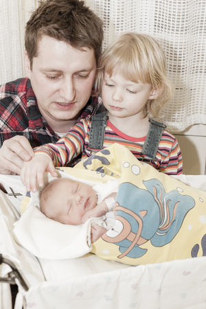 maternal: portrait of father with her daughters in maternal hospital Stock Photo