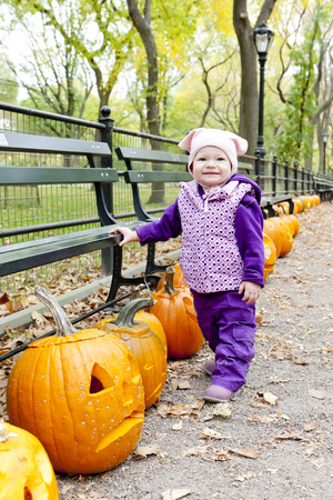falltime: little girl in autumnal Central Park, New York City, USA