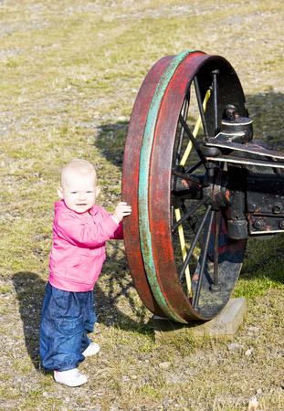 steam traction: little girl standing at wheel, Mount Washington Cog Railway, Bretton Woods, New Hampshire, USA