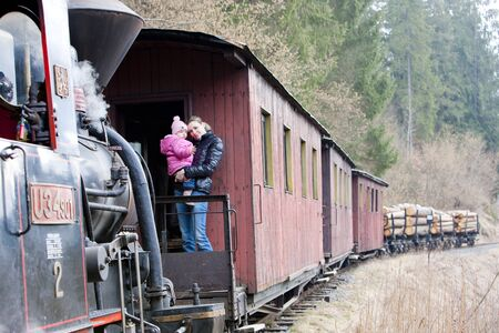 steam traction: mother with her daughter traveling by train, Ciernohronska Railway, Slovakia