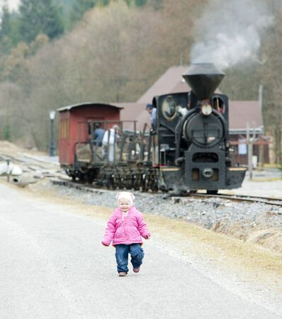 goods train: litte girl and steam train, Ciernohronska Railway, Slovakia Stock Photo
