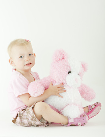 infantile: sitting toddler with a teddy bear Stock Photo