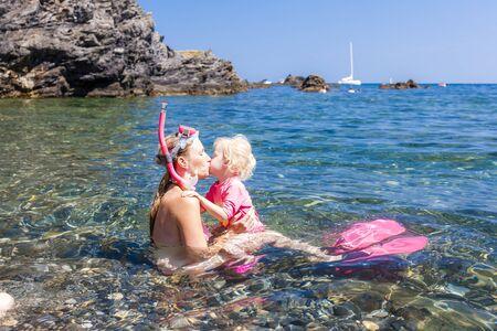 mum and daughter: snorkeling in Mediterranean Sea, France