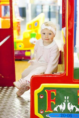 go inside: sitting toddler on carousel