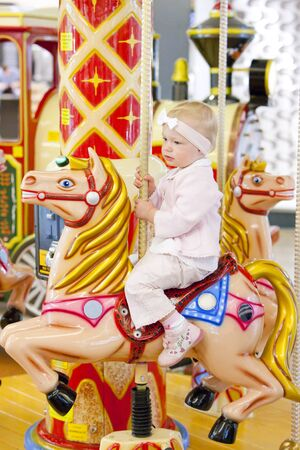 go inside: sitting toddler on carousel