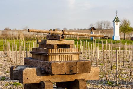 winepress: wine press and wayside with vineyard near Velke Bilovice, Czech Republic Stock Photo