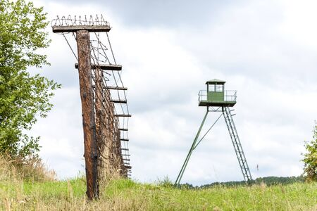 bearded wire: patrol tower and remains of iron curtain, Cizov, Czech Republic Stock Photo