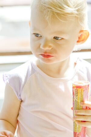 tempt: portrait of little girl with ice cream