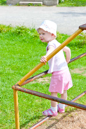 climbing frame: little girl on climbing frame