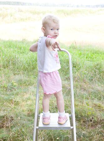 1 2 years: little girl standing on ladder