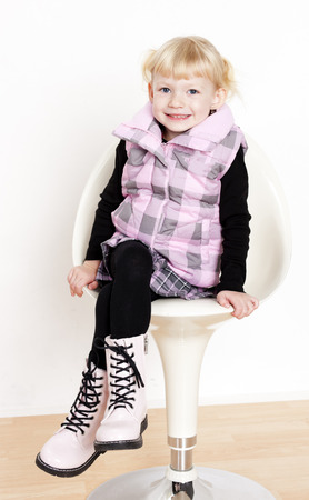 little girl sitting: little girl sitting on chair Stock Photo