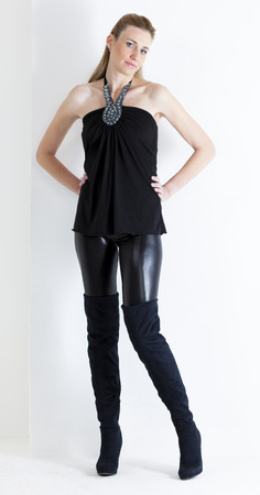 black boots: standing woman wearing black clothes and black boots