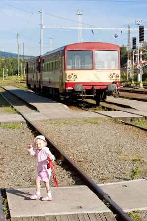 traction engine: litte girl at railway station, Czech Republic