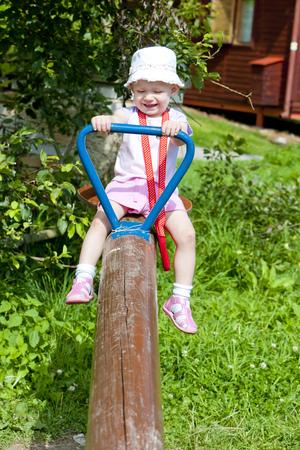 little girl sitting: little girl sitting on swing