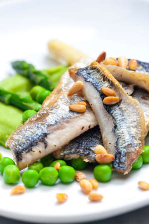 pine kernels: herring with green asparagus and peas Stock Photo