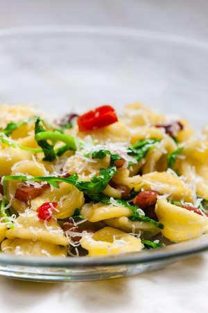 ruccola: pasta orecchiette with ruccola and bacon Stock Photo