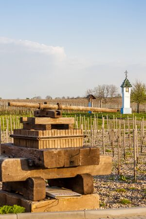 wine press and wayside with vineyard near Velke Bilovice, Czech Republic Stock Photo