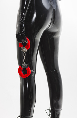 domina: detail of standing woman holding handcuffs Stock Photo