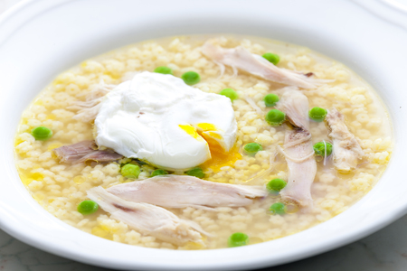 poultry soup with poached egg