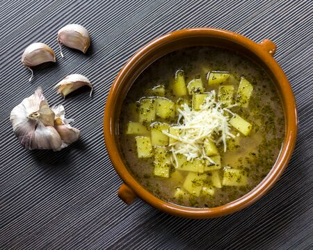 garlic soup with potatoes and marjoram