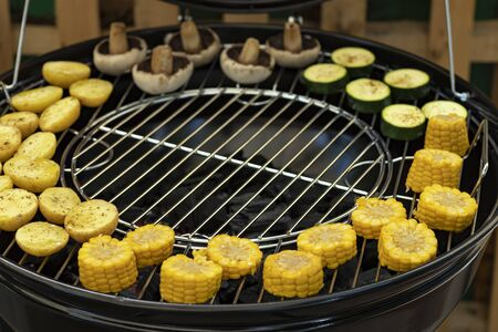 grill with potatoes, turkey meat, zucchini, mushrooms and sausages