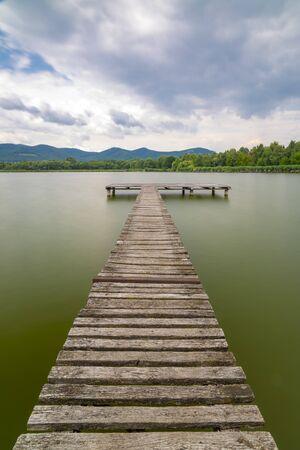 Pier on the pond Jenoi-to, Hungary