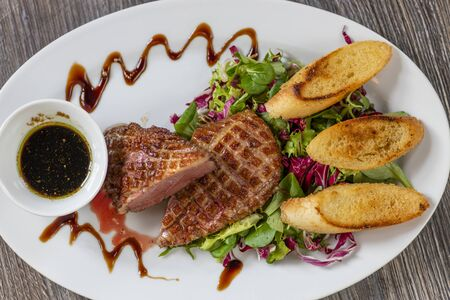 grilled duck breast with honey sauce and salad