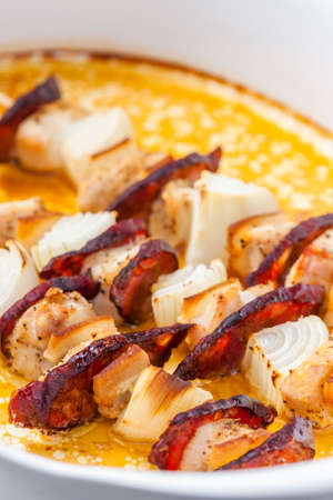 skewers with meat, bacon and onion 写真素材