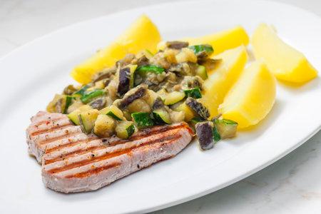 grilled tuna steak with zucchini, aubergine and cooked potatoes