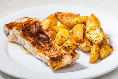 baked salmon with thyme potatoes 写真素材