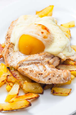 meat baked with peach and cheese served with french fries