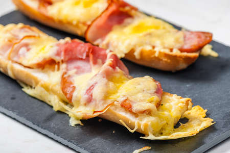 baguette baked with ham and cheese
