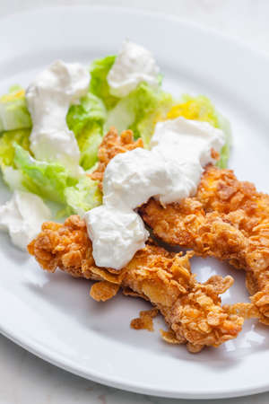 fried chicken in cornflakes with lettuce and garlic dip