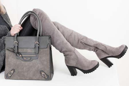 gray women's boots with a handbag