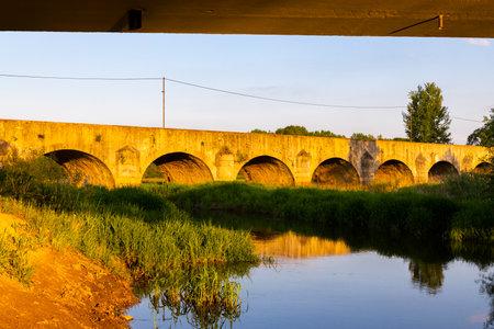 Old stone bridge over Vitek pond near Trebon, Southern Bohemia, Czech Republic