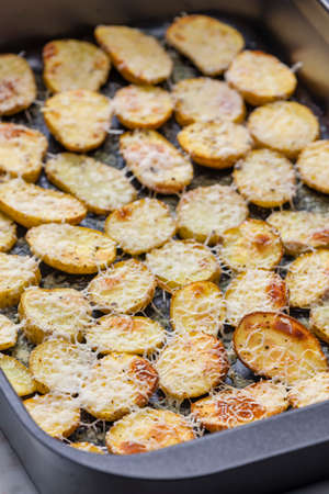 slices of potatoes baked with grated cheese