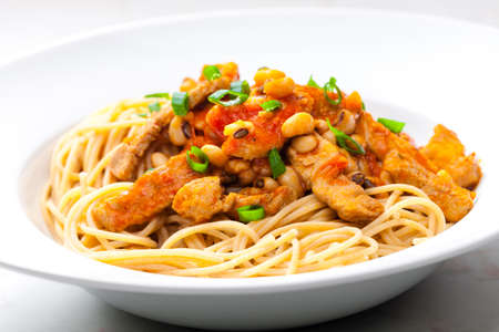 spaghetti with poultry meat, tomato sauce and beans 写真素材