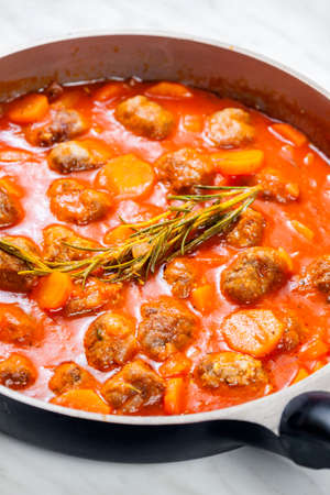 meat balls in tomato sauce with carrot