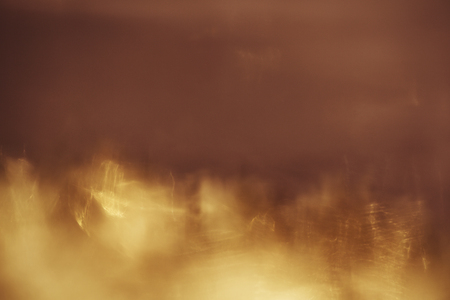 abstract background. Golden sparks and a cloud of dust. Stock Photo