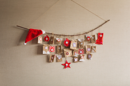 the advent calendar hanging on the wall. small gifts surprises for children.