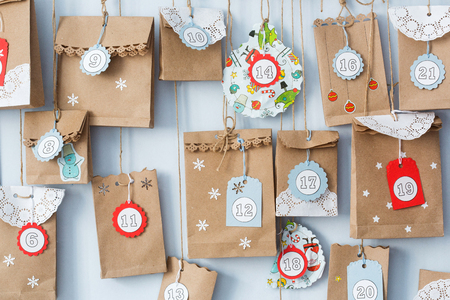 advent calendar with small gifts close up. Archivio Fotografico