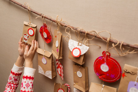 childs hands holding a gift from advent calendar