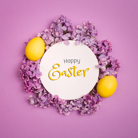 yellow Easter egg as Lily of the valley flower on purple background. minimalism, copy space. happy Easter text
