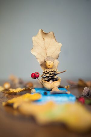 autumn craft with kids. childrens cute boat with man made of natural materials