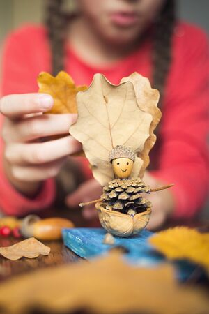 autumn craft with kids. childrens cute boat with man made of natural materials. process of creating Banco de Imagens